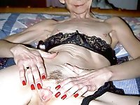Immoral old chick taking off her bra